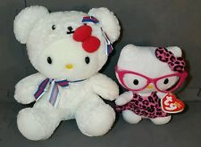 Hello Kitty plush dolls (RARE) Bear outfit. Hot pink glasses & animal print bow.