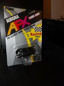 TOMY AURORA AFX BLACK PORSCHE (?) SLOT CAR NEW OLD STOCK 1989