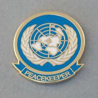 UNITED NATIONS PEACEKEEPER LAPEL BADGE ENAMEL & GOLD PLATING 25MM HIGH W/1 PIN