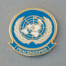 UNITED NATIONS PEACEKEEPER LAPEL BADGE ENAMEL & GOLD PLATING 25MM HIGH W/1 PIN