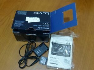 Caja, intrucciones, cargador y batería de cámara de fotos Panasonic DMC-TZ1