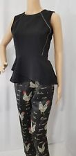 H & M size 10 peplum top sleeveless black knit silver trim ,back zipper