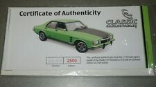 1:18 CLASSIC CARLECTABLE HOLDEN MONARO HX GTS GREEN CERT & BOOKLET, OPENED