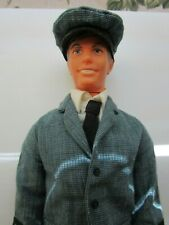 Live Action Ken doll wearing United Pilots Uniform