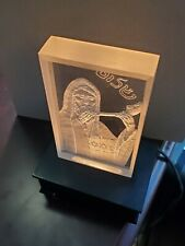 "Backlit hand-carved glass shofar blower marked ""Dekel's"""