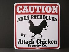 Sign: Caution Area Patrolled By ATTACK CHICKEN SECURITY CO.