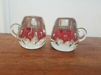 Teacup paperweight  set with red flowers and controlled bubbles, also sm vase