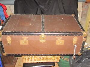 Vintage cabin travelling steamer trunk.