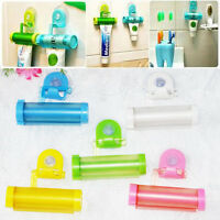 New Easy Squeeze Out Toothpaste Dispenser Rolling Bathroom Hanging Holder Sucker