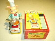 nice vintage mechanical piggy cook toy