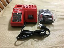 Brand New Milwaukee M12 & M18 Dual Charger plus 1 New M18 Battery 48-11-1815