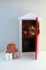 Opening Christmas elf door with santa workshop image and miniature presents