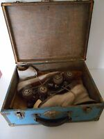 VINTAGE ROLLER SKATES WITH A BLUE METAL CARRYING CASE