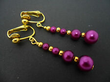 A PAIR OF DANGLY PURPLE GLASS PEARL  GOLD PLATED CLIP ON   EARRINGS.