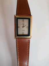 Omega deVille vintage push button ladies watch. Leather strap