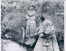 1957 Pretty 1950s Women Fishing Pulling Fish on Line to Skillet Press Photo