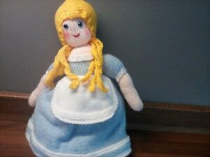 topsy turvy doll with book