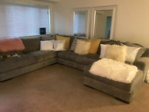 Grey Sectional, like brand new , warranty included . Ashely's furniture,
