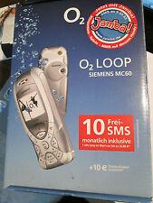 Siemens  MC 60 in OVP SIMO2 Loop silber Ladeteil Heft super ok gebr Art Nr. 39P