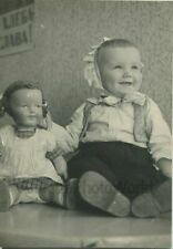 Russian happy smiling baby posing with large doll vintage toy photo