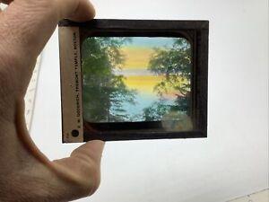 magic lantern slide: trees, water, sky in color