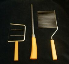 3 Vintage Butterscotch Bakelite Serving Utensils Two Slicers and Knife Sharpener