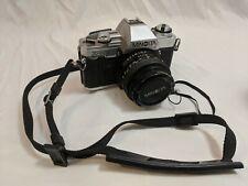 Vintage Minolta X-370 Camera with 50mm Lens and shoulder strap