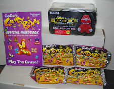 #5075 Go Go's Crazy Bones Handbook, 4 Unopened Packs & Collectors Tin Gold