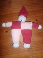 Doudou bonhomme au tricot fait main pour bébé