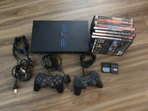 Sony PlayStation 2 PS2 System w/8 games TESTED AND WORKING