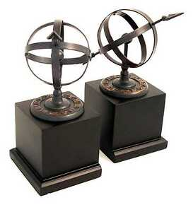 Cast Metal Sundial Bookends with Verdigris Finish on Black Wood Base.