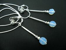 A PRETTY FACETED OPALITE BEAD NECKLACE AND  CLIP ON EARRING SET. NEW.