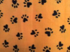 "black paw animal dog print fleece on yellow fabric 60"" wide, sold by the yard"