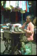 083050 Woman Sewing Clothes On Street In Front Of Shop Gianyar A4 Photo Print