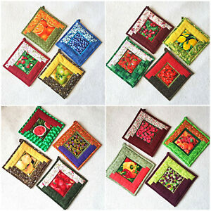 Quilted potholders. Handmade hot pads. Patchwork set potholders. Fruits, berries