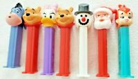 Lot of 7 Pez Dispensers With Feet, Holiday Santa, Snowman, Pebbles, Daisy, Pooh