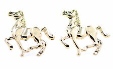 Gold tone galloping horse stud earrings