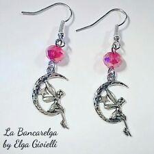 Orecchini con fate e cristalli rossi. Fairy earrings with red crystal
