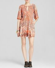 NWT FREE PEOPLE SzM LOVE BIRDS CUTOUT SHOULDERS MINI DRESS IN CLEMENTINE COM$148