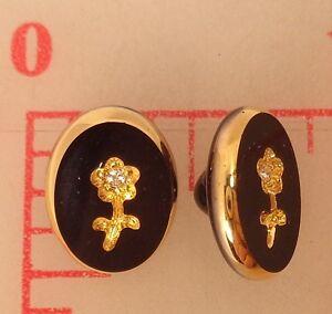 2 Vintage Black Glass Oval Shank Buttons Engraved Gold Flower Germany Intaglio
