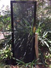security doors , a pair of black hinged stainless steel security doors