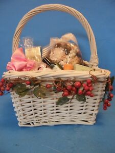 SQUARE WHITE WICKER BASKET WITH BRAIDED HANDLE FULL OF BEAUTY/HEALTH PRODUCTS