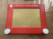 Vintage Etch-a-Sketch, red.