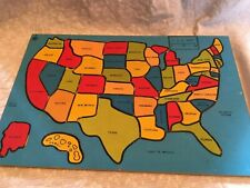 puzzle wooden USA State capitals are under the pieces.  Made in Taiwan.