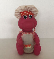 vintage big eyes sitting baby dinosaur wearing chef apron and hat