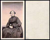 CIVIL WAR ERA CDV PHOTO PORTRAIT OF A WOMAN IN BLACK DRESS NO PUBLISHER INFO.