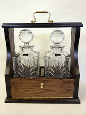 Tantalus with Oak Veneered Frame and Metal Fittings plus Two Bohemia Decanters