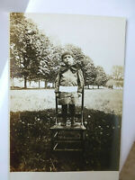 RPPC Cute Little Boy Big Bow as Tie Standing on Chair Old Real Photo Postcard