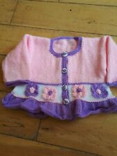 Handknitted pink/lilac girls cardigan with flowers