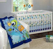 NEW DISNEY MONSTERS INC ON THE GO 4-PIECE BEDDING BABY CRIB / TODDLER BED SET.